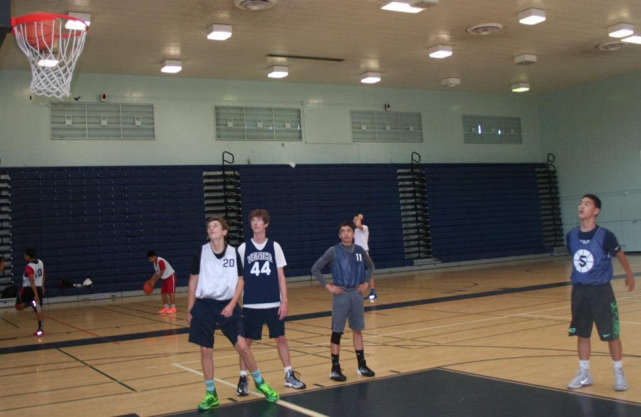 The basketball team prepares for the season by running free-throw drills