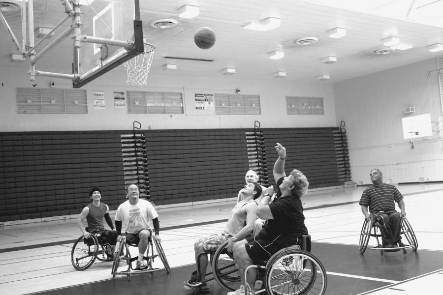 Angela Madsen scores some hoops in the West Gym at the wheelchair basketball game.