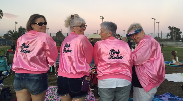 Grease+fans+dressed+up+as+Pink+Ladies+at+Grease+Night+Sept.+26+on+the+football+field.