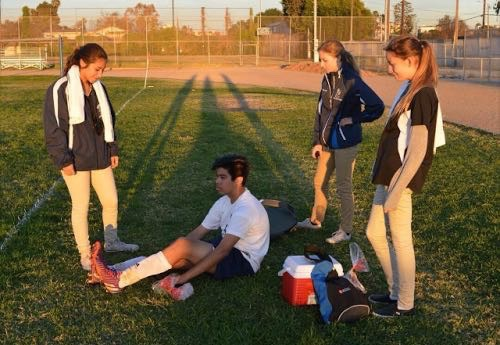 The Sports Medicine team prepares to act on an injury.
