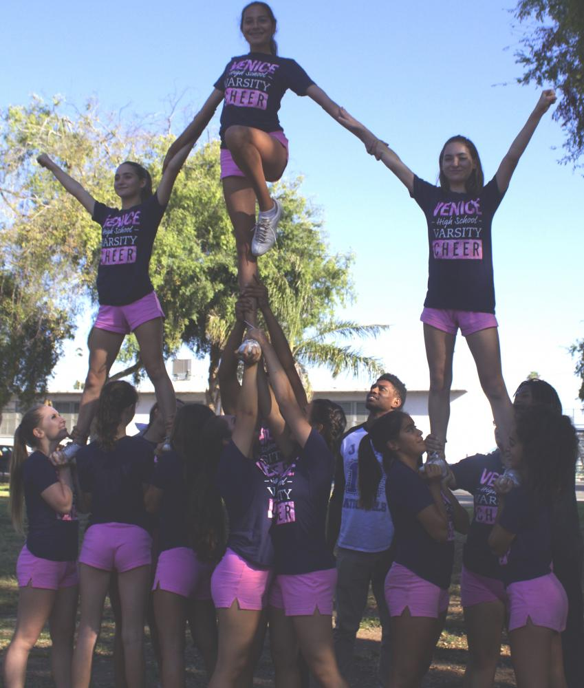 Cheerleaders stunting during practice.