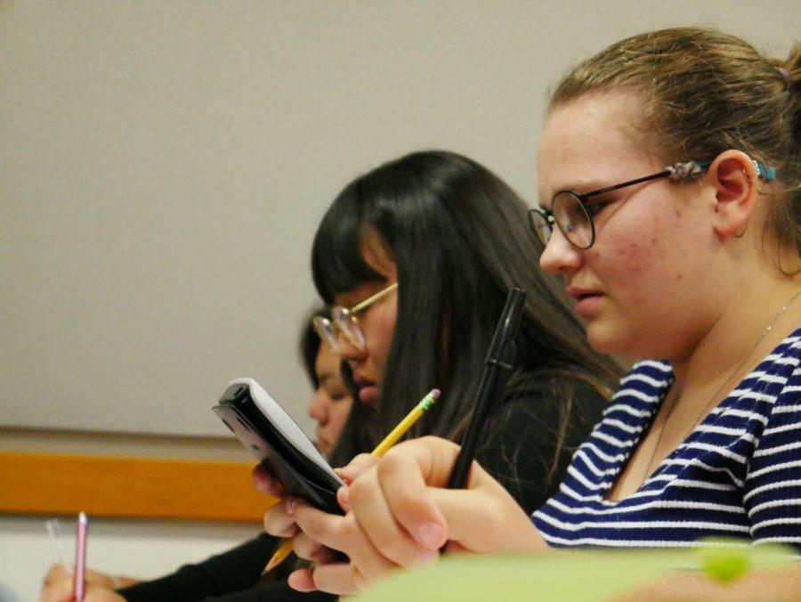 Juniors Camryn Butze and Alissa Okada attending a chemistry lecture.
