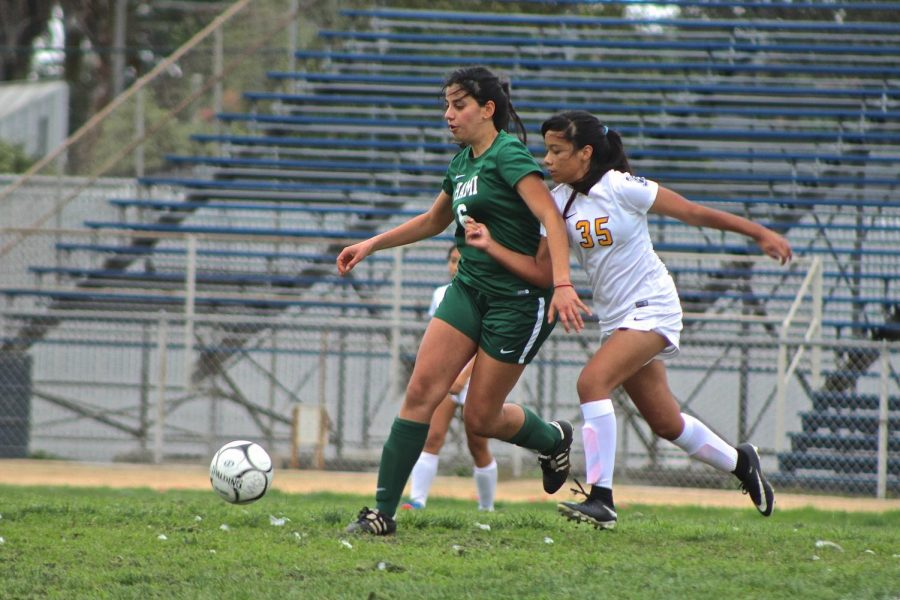Jennifer Ayala, number 35, fighting for the ball