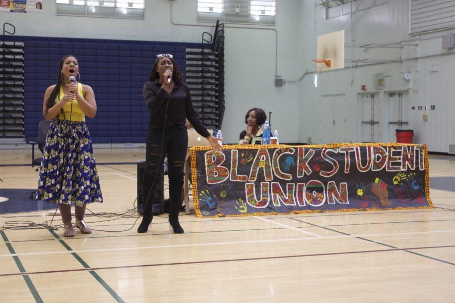 Olivia Atlas and Shara Wade singing