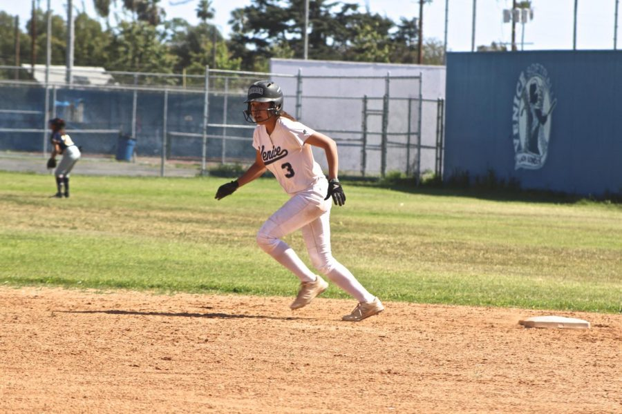 Destiny Reyes, number 3, runs towards 3rd base