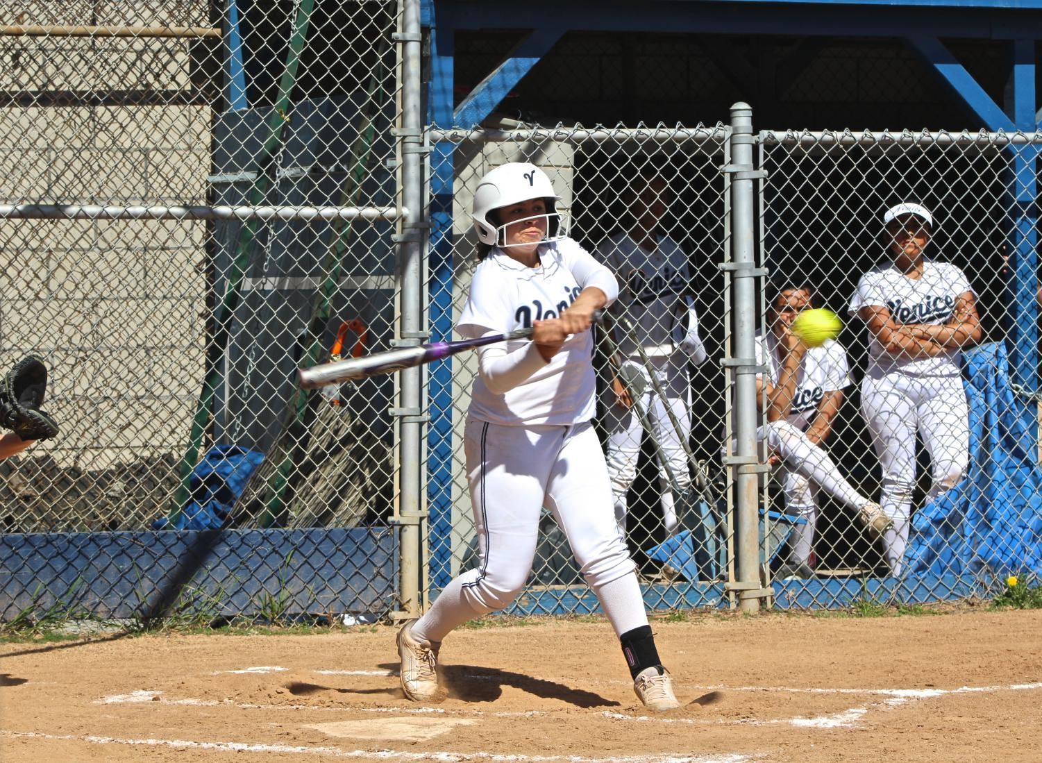 Savanna Aguayo, number 15, swinging bat
