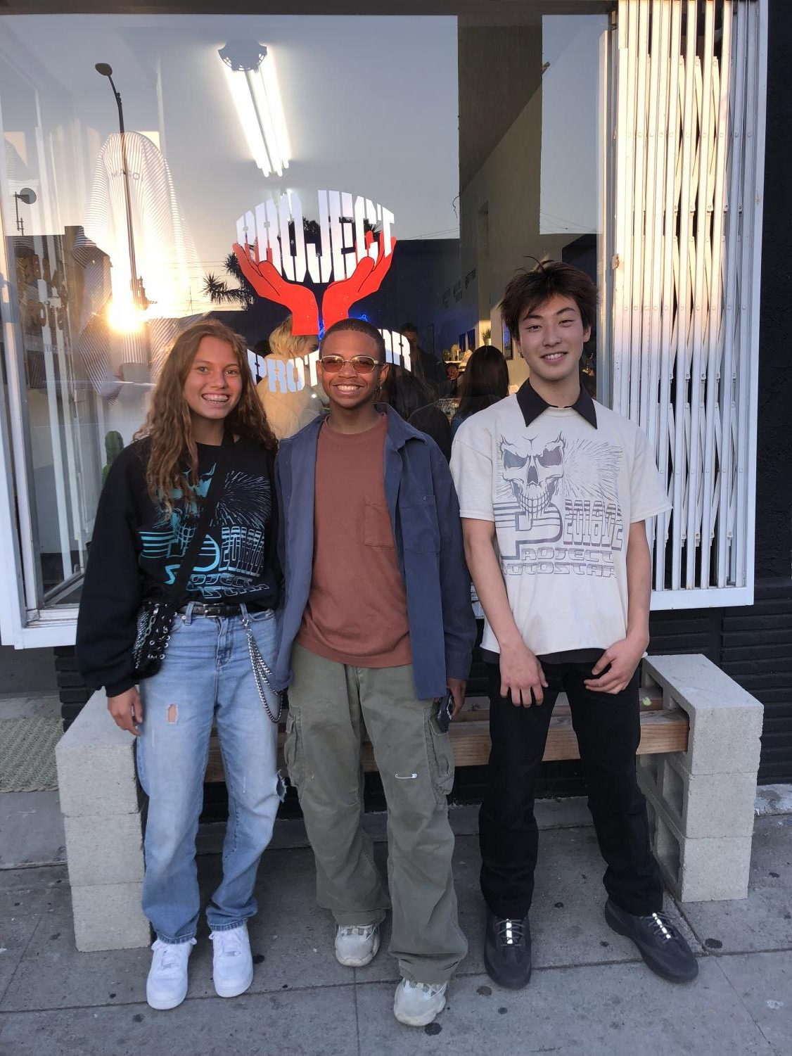 Designer Antonio Finamore (middle) along with models Cailee Pupecki and Shu Watanabe posing in front of the pop up shop