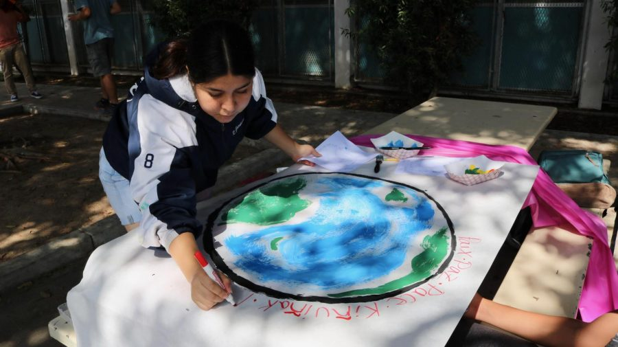 Students make posters for Peace Day.