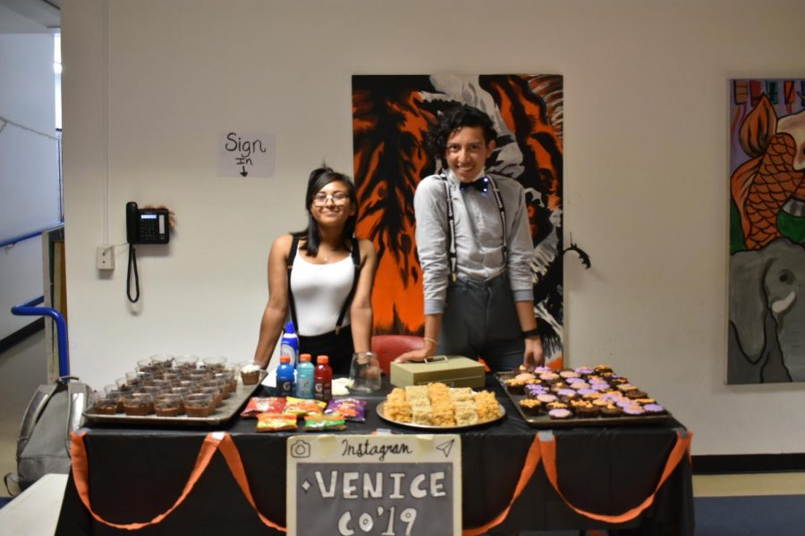 Two students selling snacks for Club of 2019