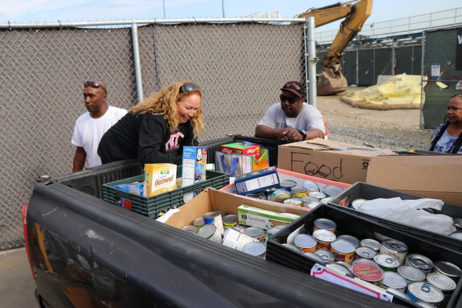 ASB helps load the donations gathered in their Food Drive onto a truck.