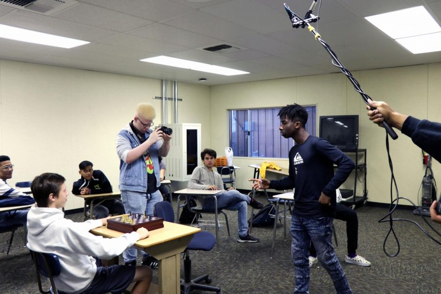 Kaleb Dion Frelix (left) films a scene with actor and creator Kylon Wade (center).