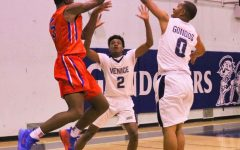 Seniors Daryl Tate and Dorien Thompson guard an opposing player in Winter 2019.