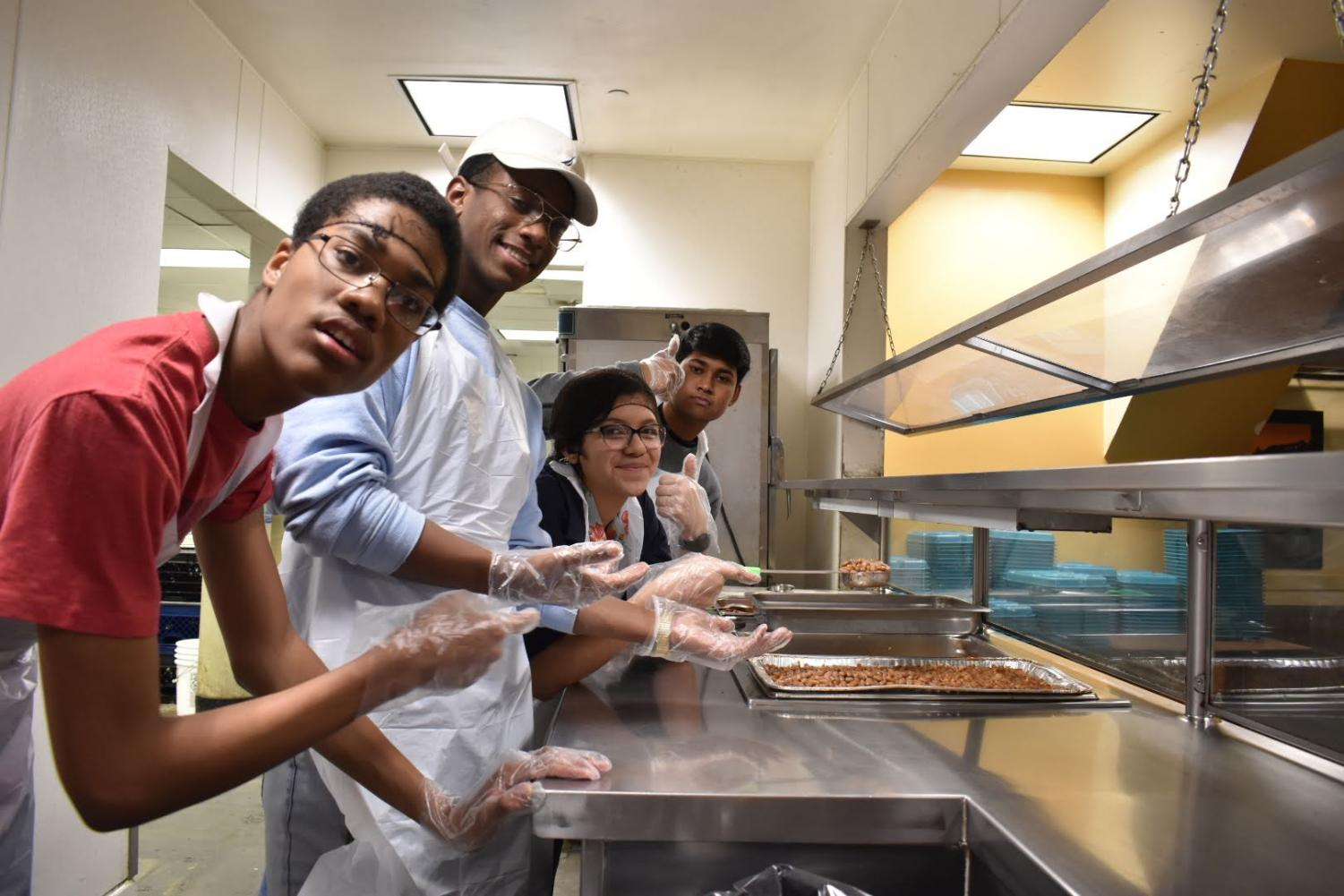 Students help feed the less fortunate at Midnight Mission.
