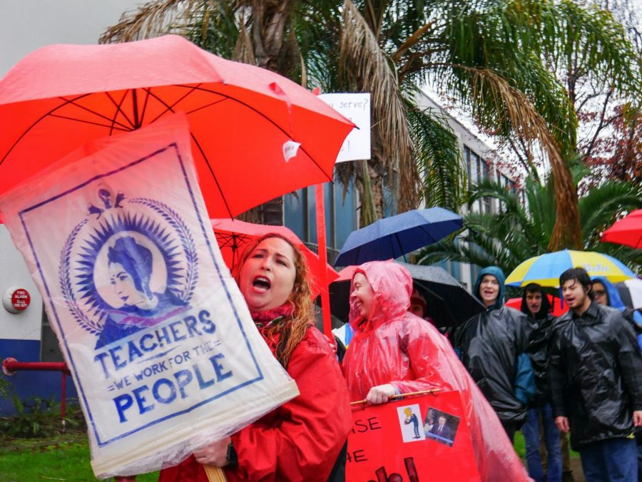 %22Rain+or+shine+we+walk+the+line%21%22+chant+the+crowd+of+teachers+and+students%2C+as+they+march+outside+the+picket+line.