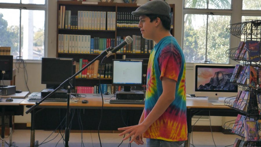 Andrew+performs+for+the+classic+Poetry+Slam+hosted+in+the+library.