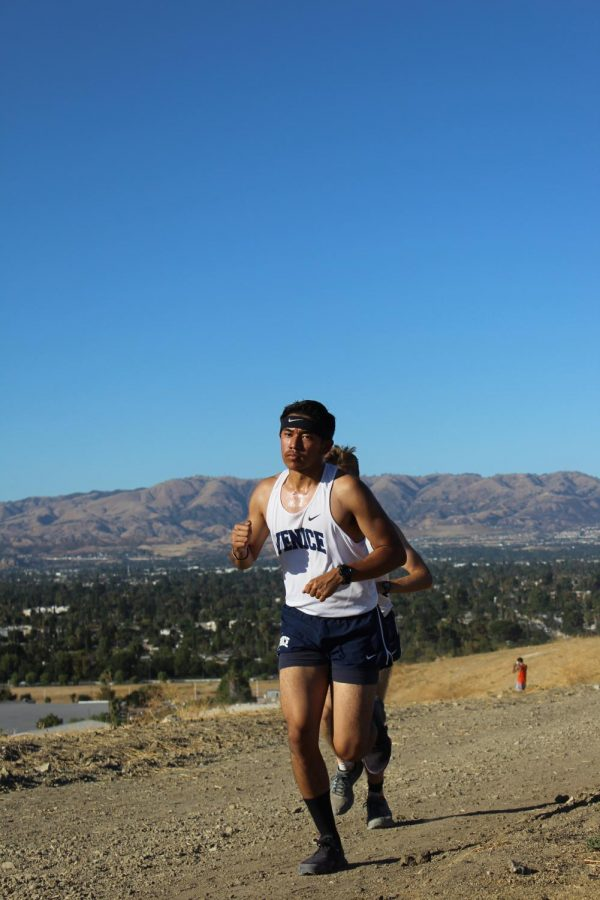 Junior Varsity runner Ian Santos.