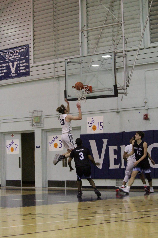 Varsity boys Basketball team playing against Palisades High