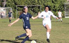 Evelyn Lamond taking the field against R.F Kennedy High