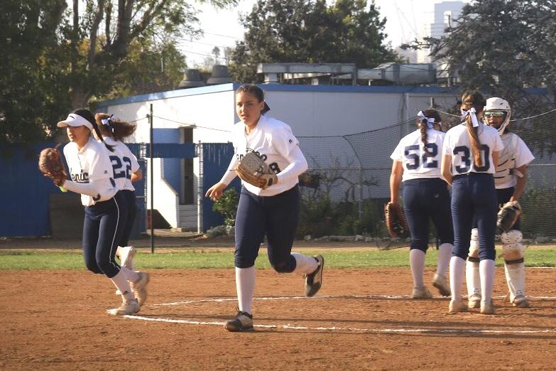 Varsity Girls Softball taking the field against Hamilton High.