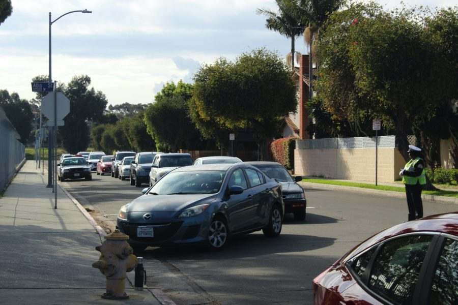 A long line of cars waiting on the side of Marina Del Rey Middle School to get their meal.