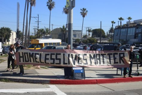 Pro-public housing citizens advocate for homeless rights in Venice.