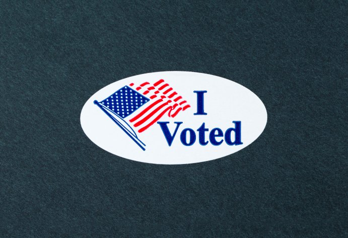 'I Voted' sticker on the black background.
